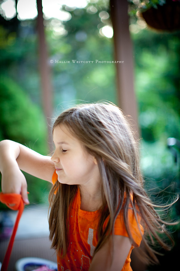 Little girl dances and spins on the front porch in Tolland, CT