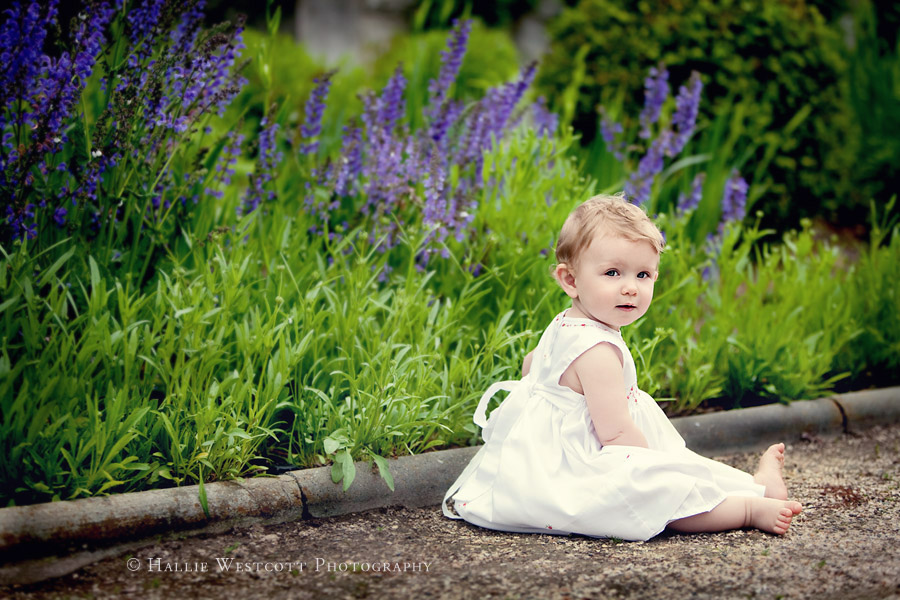 Photo of baby girl sitting in the gardens at Harkness Park in Waterford, CT