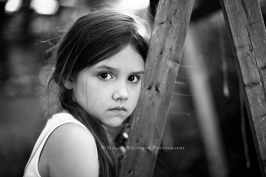 Tolland, CT family photographer captures a girl leaning on a pea trellis