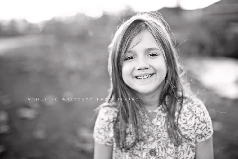 Manchester, CT Photographer photographs a little girl playing outdoors